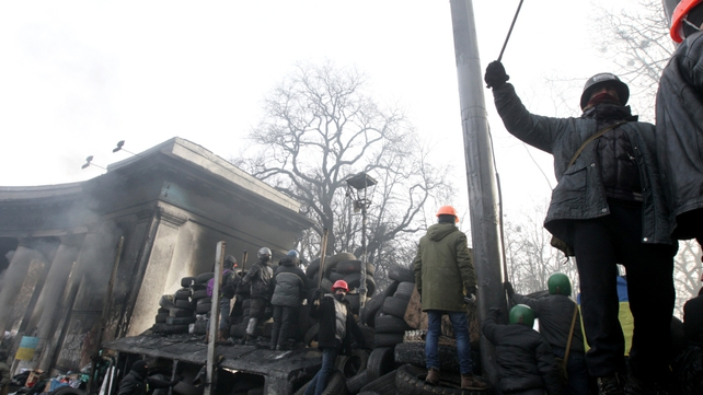 Protesters stand on a barricade during another day of anti-government protest in Kiev (Pic: EPA)