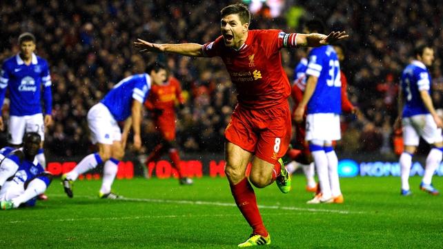Steven Gerrard celebrates Liverpool's opening goal in tonight's demolition of Everton