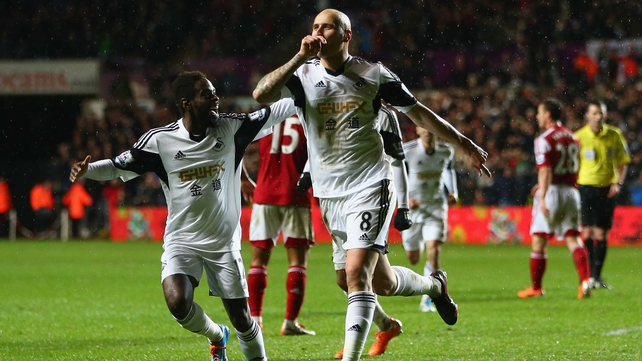 Jonjo Shelvey celebrates Swansea's opening goal in their victory over Fulham