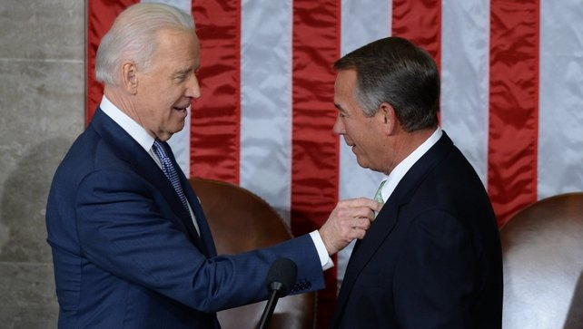 US Vice President Joe Biden (L) confers with Speaker of the House John Boehner (R), prior to State of the Union address