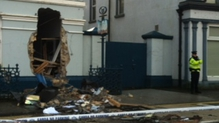 CCTVfootage was shown to the jury in which a digger pulled the ATM out of the front wall of the bank and then placed it on a trailer