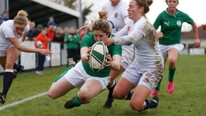 Ireland wing Alison Miller scores one of her three tries against England last year
