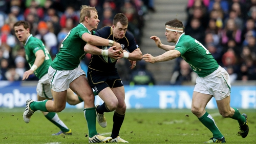 Stuart Hogg is tackled by Brian O'Driscoll and Luke Marshall last year