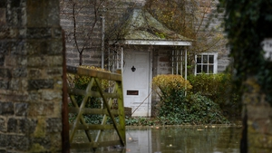 Flood water surrounds a house in the village of Thorney in Somerset