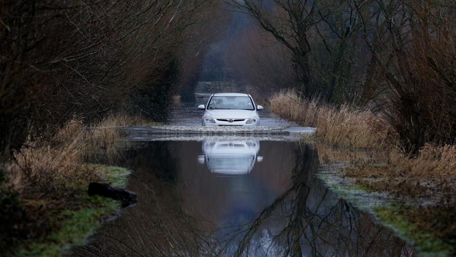 A car drives through flood water near Langport