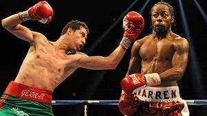 German Meraz attempts to hit Rau'shee Warren in their bantamweight match