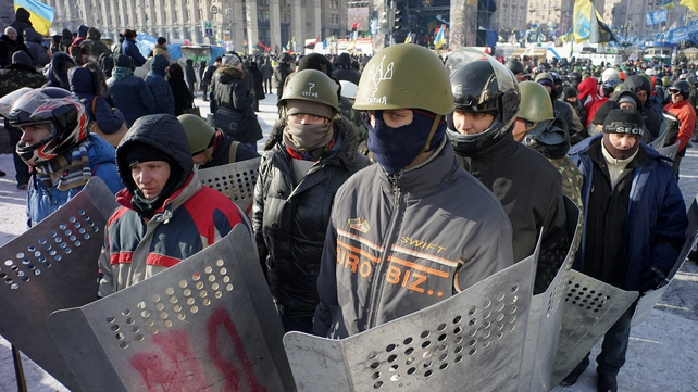 Protesters protect take up shields for protection in Kiev's Independence Square