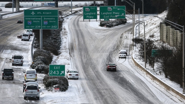 Abandoned vehicles litter the roadway in the aftermath of a winter storm in Atlanta, Georgia