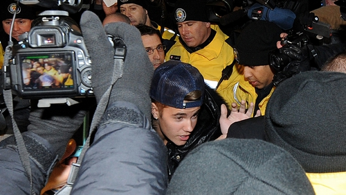 Justin Bieber - presented himself to police in Toronto yesterday