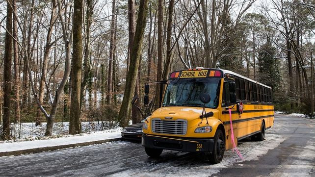 An abandoned Atlanta Public School bus sits in the ice during the winter storm in Georgia