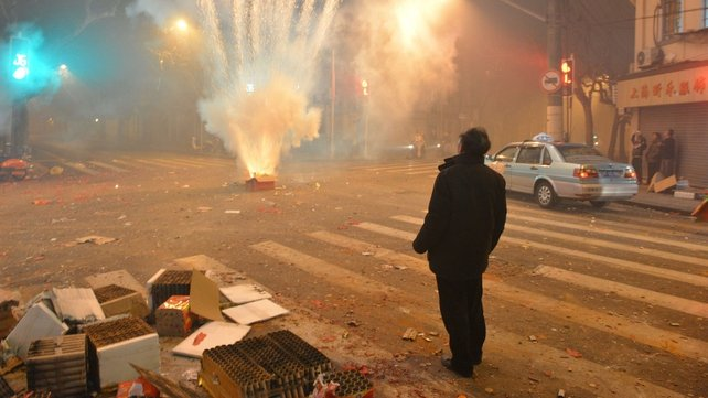 Fireworks explode in a Shanghai street on the eve of Chinese New Year