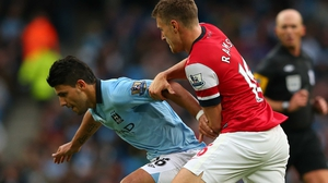 Sergio Aguero (l) and Aaron Ramsey are set to miss a crucial period in the race for the Premier League title