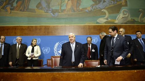 Syria's Foreign Minister and head of the Syrian government delegation Walid Muallem (C) gave a press briefing on the peace talks