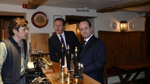 British Prime Minister David Cameron and French President Francois Hollande arrive for an informal lunch at The Swan Inn pub in Oxfordshire, England
