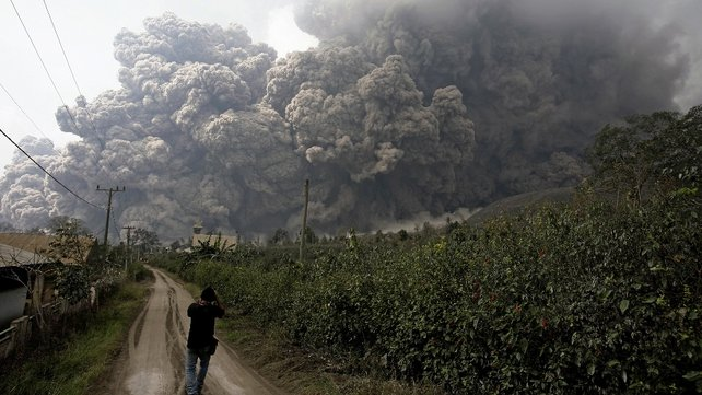 A journalist captures images of the ash cloud (Pic: EPA)