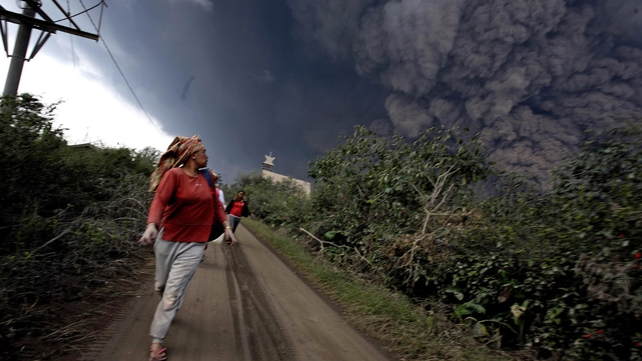 Residents flee the dangerous ash cloud (Pic: EPA)