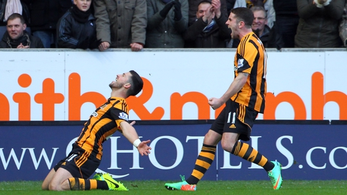 Shane Long celebrates his debut goal for Hull with team-mate Robbie Brady