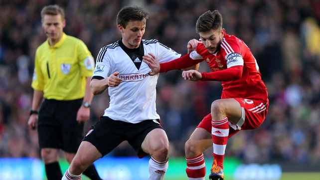 William Kvist of Fulham in action against Adam Lallana of Southampton
