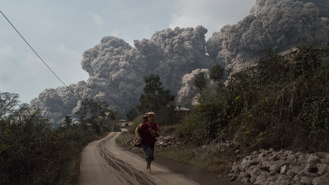 Local people flee ash cloud
