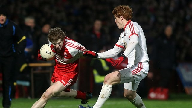 Derry's Enda Lynn tries to escape the attentions of Peter Harte
