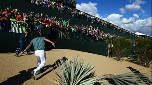 Bubba Watson throws souvenirs into the crowd