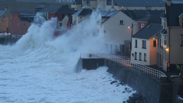 Waves crash over the sea wall at Lahinch, Co Clare