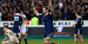 Pascal Pape celebrates as England's Owen Farrell looks dejected