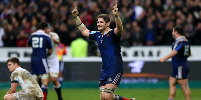Pascal Pape celebrates as England's Owen Farrell looks dejected