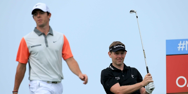 Stephen Gallacher and Rory McIlroy in action on the final day of the Dubai Desert Classic