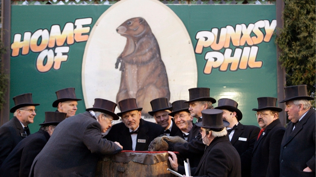 The inner circle gathers around the famous weather prognosticator Punxsutawney Phil