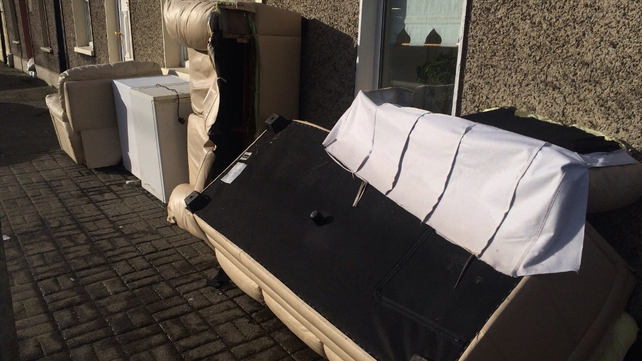 Furniture damaged in the Limerick floods left outside homes