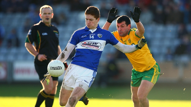Evan O'Carroll of Laois gets his shot away under pressure from Frank McGlynn