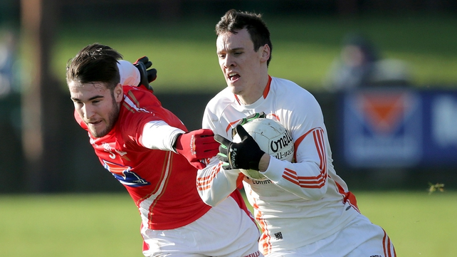 Patrick Reilly of Louth tackles Mark Shields of Armagh