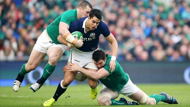 Cian Healy and Peter O'Mahony tackle Sean Maitland