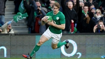Andrew Trimble believes that they have to step up their performance level to beat England