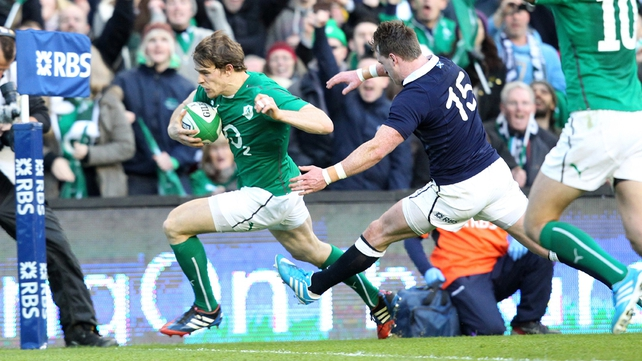 Andrew Trimble sprints past Scotland full back Stuart Hogg for Ireland's first try