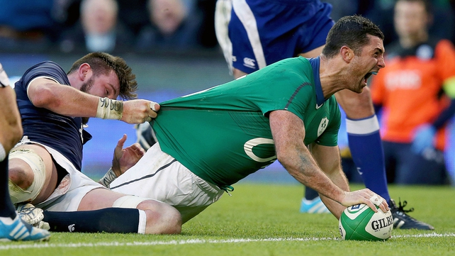 Rob Kearney celebrates as he goes over for his score