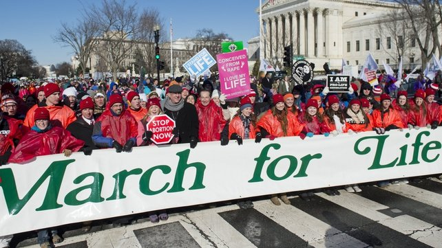 Anti-abortion demonstrators protest as they walk past the US Supreme Court during the 41st annual March of Life in Washington