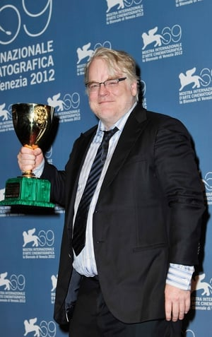 Philip Seymour Hoffman with the Best Actor award at the 2012 Venice Film Festival
