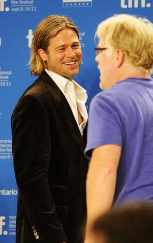 Brad Pitt and Philip Seymour Hoffman in 2011