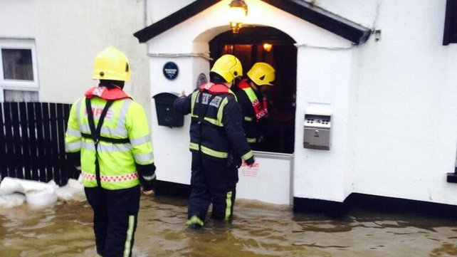 Fire brigade arrived to try to help the McAlpins in Co Waterford (Pic @AltitudeIreland)