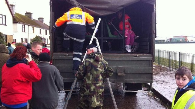 The army is assisting in Limerick, moving residents to higher ground