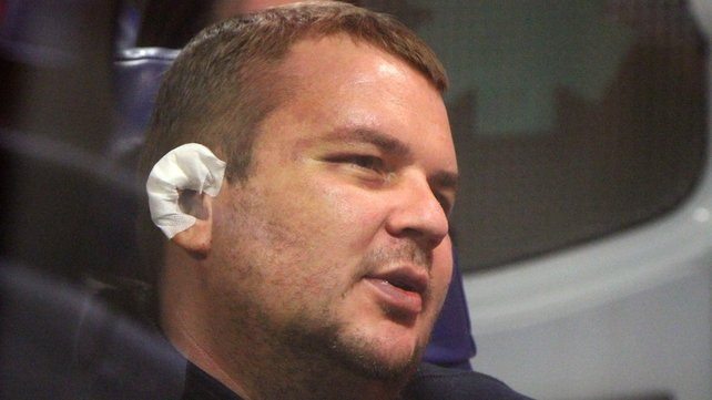 Opposition activist Dmitry Bulatov sits in an ambulance at Vilnius airport