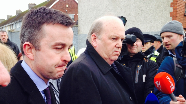 Michael Noonan (centre) said additional funding would be provided from the national budget