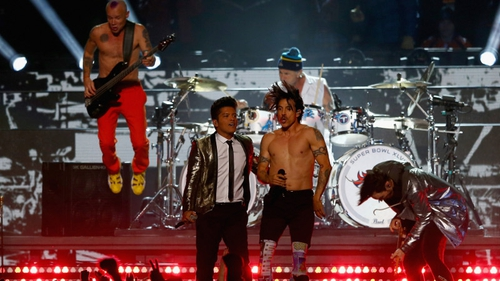 Flea (left) on stage with the Red Hot Chili Peppers
