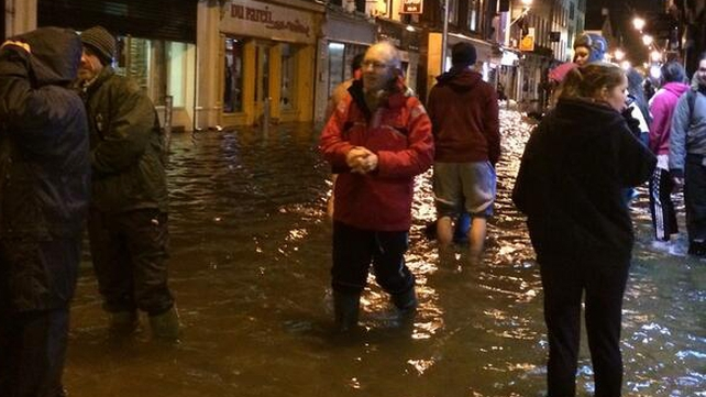 Business owners on Oliver Plunkett Street tried to stop cars creating waves