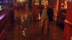 Joe Donnelly stands in a flooded Counihan's Bar