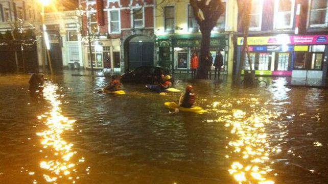 People kayak along the Grand Parade in Cork