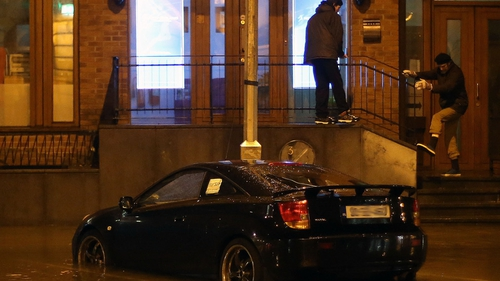 A car is abandoned in flood water in Cork as much of the city centre flooded last night