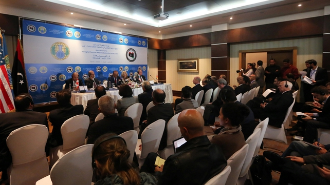 Journalists attend a press conference held by the Organisation for the Prohibition of Chemical Weapons (OPCW) in Tripoli